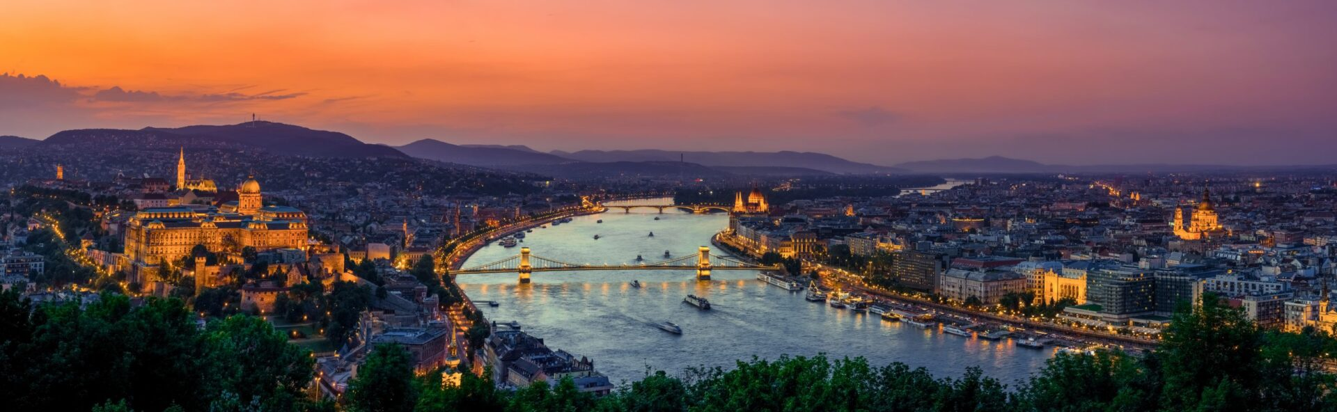 Budapest, Hungary sunset view with Danube river, Parliament, Castle. View from Gellert Hill